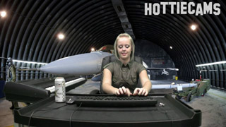 Jenna Suvari was assigned desk jockey duty during her tenure in the Air Force. What's a girl to do in a lonely hanger with only a military mannequin near her?